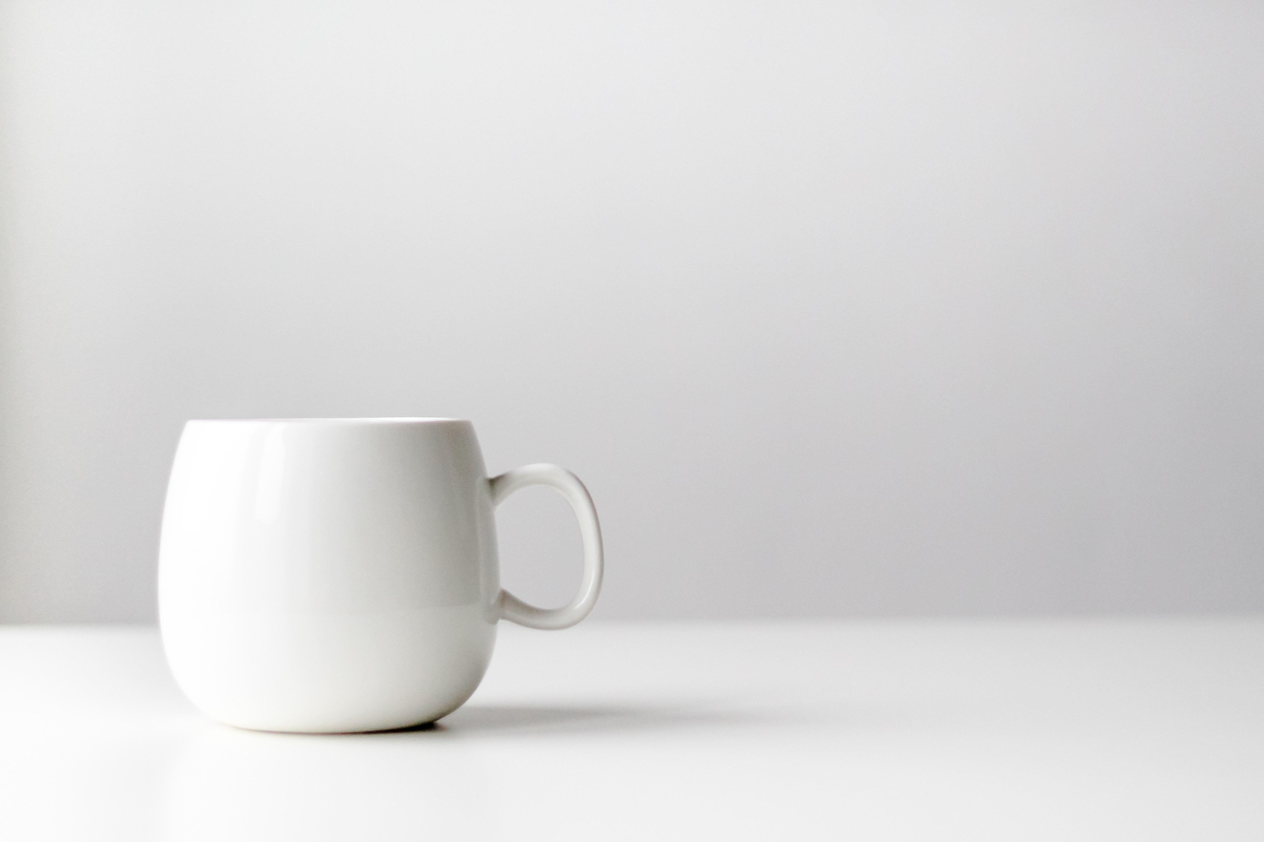 How To Mockup Your Logo On A Free Stock Photo Of A Coffee Mug Wegraphics